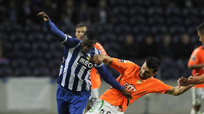 FC Porto's Jackson Martinez, from Colombia, left, challenges Vitoria Setubal's Daniel Soares, in a Portuguese League soccer match at the Dragao Stadium in Porto, Portugal, Sunday, Jan. 19, 2014