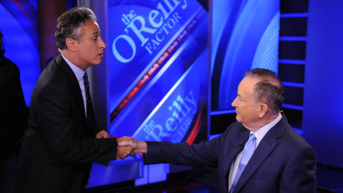 """FILE - In this Sept. 22, 2010 file photo, Comedy Central's Jon Stewart, left, and Bill O'Reilly tape an interview in New York. Stewart and  O'Reilly, a celebrity odd couple with a history of public political feuds, tangle in a sold-out debate in Washington. The so-called """"Rumble in the Air-Conditioned Auditorium"""" offers a jocular sideshow to the series of three more somber debates this month between President Barack Obama and Republican Mitt Romney.  (AP Photo/Peter Kramer)"""