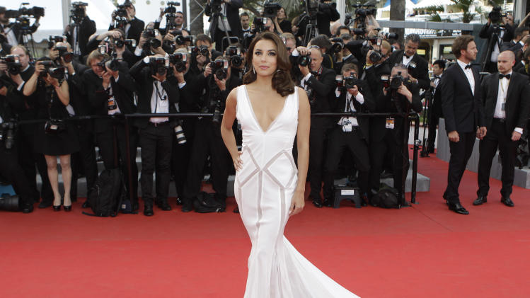 Actress Eva Longoria arrives for the screening of Rust and Bone at the 65th international film festival, in Cannes, southern France, Thursday, May 17, 2012.  Longoria is wearing Emilio Pucci.(AP Photo/Francois Mori)