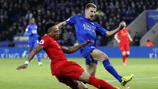 Liverpool's Nathaniel Clyne in action with Leicester City's Marc Albrighton