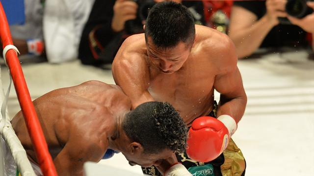 Boxing - Uchiyama defends featherweight belt, Solis wins fly title