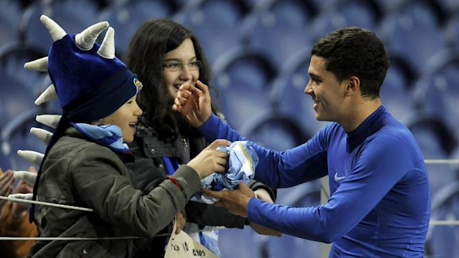 FC Porto's Juan Quintero, from Colombia, gives his shirt to a fan on the stands after their victory over Belenenses in a Portuguese League soccer match at the Dragao stadium in Porto, Portugal, Sunday, March 23, 2014. Quintero scored the only goal in Porto's 1-0 victory