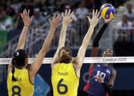 USA's Destinee Hooker (19, right) prepares to smash the ball past Brazil's Jaqueline Carvalho (8) and Thaisa Menezes (6) during a women's volleyball gold medal match at the 2012 Summer Olympics Saturday, Aug. 11, 2012, in London. (AP Photo/Chris O'Meara)