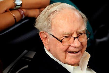 Berkshire Hathaway CEO Warren Buffett waits to play table tennis during the Berkshire Hathaway annual meeting weekend in Omaha, Nebraska