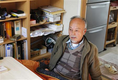 Norio Horiuchi, an evacuee from the town of Tomioka, near the tsunami-crippled Daiichi nuclear power plant, speaks during an interview with Reuters in his unit in a temporary housing estate, where 200 former Tomioka town residents also have been evacuated to, in Iwaki, Fukushima prefecture November 8, 2013. REUTERS/Sophie Knight