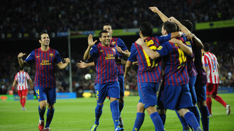 FC Barcelona players celebrate a goal against Atletico Madrid during a Spanish La Liga soccer match at the Camp Nou stadium in Barcelona, Spain, Saturday, Sept. 24, 2011. (AP Photo/Manu Fernandez)