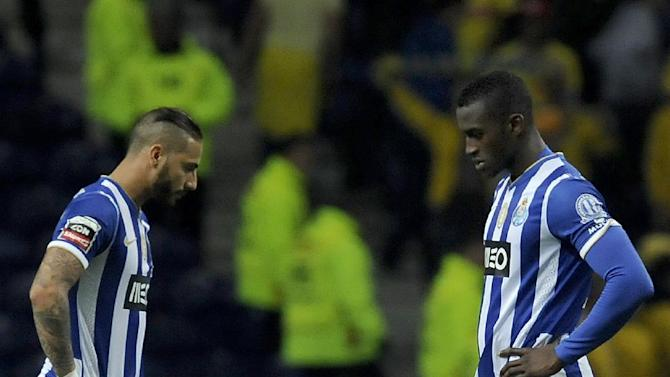 FC Porto's Jackson Martinez, from Colombia, and Ricardo Quaresma, left, react after Estoril's goal in a Portuguese League soccer match at the Dragao stadium, in Porto, Portugal, Sunday, Feb. 23, 2014. Porto lost 1-0