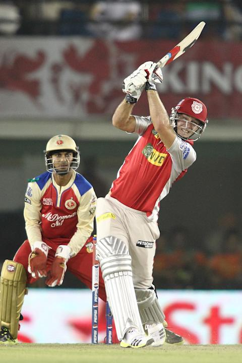 David Miller of Kings XI Punjab hits over the top for six during match 51 of the IPL