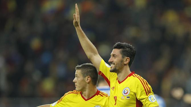Romania's Ciprian Marica, right, celebrates with Gabriel Torje, left, after scoring the second goal against Estonia during the World Cup Group D qualifying soccer match at the National Arena stadium in Bucharest, Romania, Tuesday, Oct. 15, 2013
