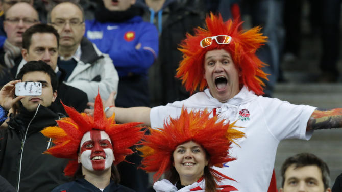 England's supporters cheer during the the British National anthem prior to a Six Nations international rugby union match between France and England at Stade de France stadium in Saint Denis, near Paris, Saturday, Feb. 1, 2014. France won against England 26-24. (AP Photo/Michel Euler)