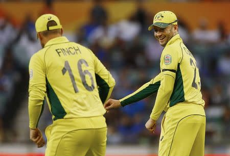 Australian captain Clarke shares a laugh with Finch, as they field during their Cricket World Cup match against Afghanistan in Perth