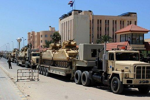 Egyptian miltary trcuks loaded with light tanks line up in el-Arish ahead of an operation to restore security in northern Sinai, on August 9. Gunfire broke out in the Sinai town of El-Arish, reports said, as tensions simmered after the Egyptian authorities vowed to crush a surge in Islamist militancy in the tense peninsula.