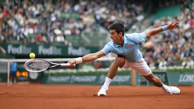 French Open - Funny man Djokovic slithers, Nadal cruises at damp Roland Garros