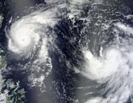 A NASA satellite image shows Typhoon Tembin (L) and Tropical Storm Bolaven (R) on August 21 in the Philippine Sea. South Korea was Monday bracing for major typhoon Bolaven, with a main port and ferry routes closed, classes cancelled, a military exercise suspended and officials put on high alert