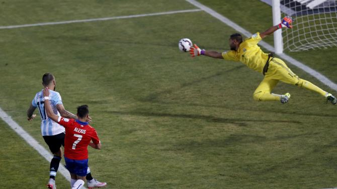 Argentina's goalie Romero lunges to stop a shot by Chile's Sanchez as Argentina's Otamendi looks on during their Copa America 2015 final soccer match at the National Stadium in Santiago