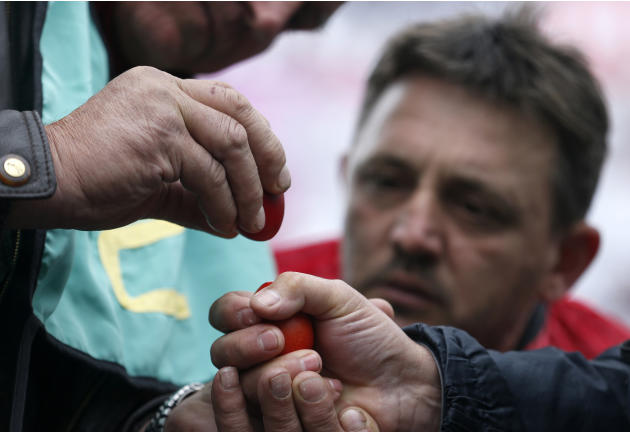 People break decorated Easter eggs as a part of the tradition of celebrating Easter in the village of Mokrin, 120 kilometers (75 miles) north of Belgrade, Serbia, Sunday, April 20, 2014. The egg crack