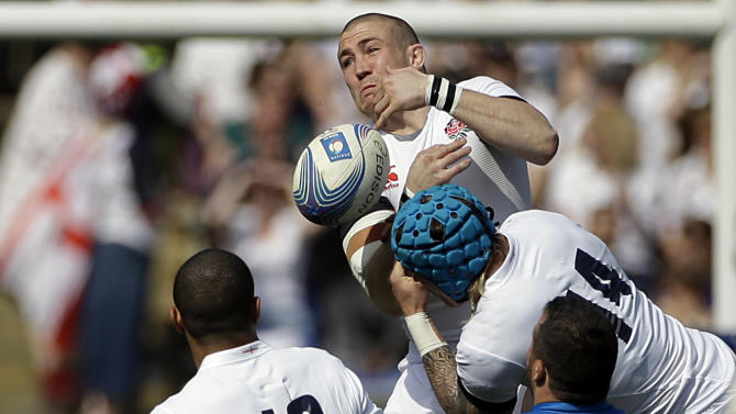 England's Mike Brown, top, collides with teammate Jack Nowell as he tries to catch the ball during the Six Nations Rugby Union match between Italy and England at Rome's Olympic stadium, Saturday, March 15, 2014. (AP Photo/Gregorio Borgia)