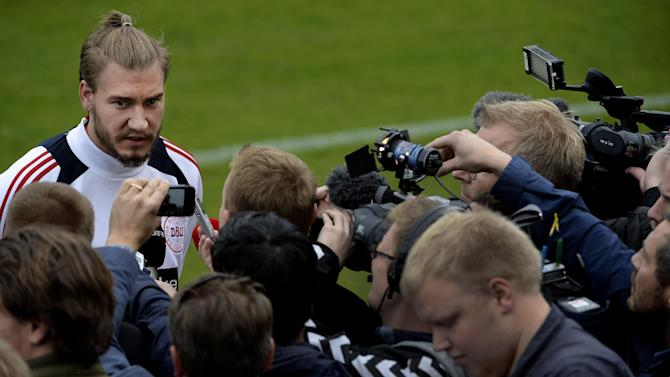 Nicklas Bendtner talks to the media before a training session with the Danish national soccer team, after a six-month absence following a conviction for drink-driving, at Helsingor Stadium, Denmark, Monday, Oct. 7, 2013. Denmark will face Italy on Friday in a World Cup qualification match in Copenhagen