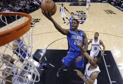 Green helps depleted Spurs pull away from Magic