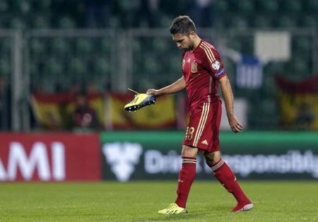Alba of Spain leaves the pitch after their Euro 2016 qualification soccer match against Slovakia at the MSK stadium in Zilina