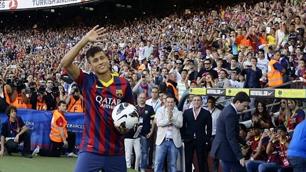 Neymar waves to Barcelona's supporters at his presentation after signing a five-year contract with the club, at Nou Camp stadium in Barcelona June 3, 2013 (Reuters)
