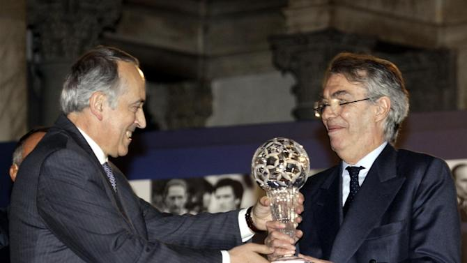 "Italian Soccer Federation president Giancarlo Abete hands over to former Inter Milan president Massimo Moratti the ""Hall of Fame"" prize for his career, during a ceremony at Palazzo Vecchio in Florence, Italy, Monday, Dec. 2, 2013"