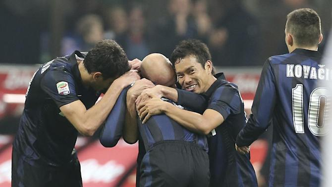 Inter Milan defender Yuto Nagatomo, second from right, of Japan, celebrates with his teammates after scoring during the Serie A soccer match between Inter Milan and Livorno at the San Siro stadium in Milan, Italy, Saturday, Nov. 9, 2013