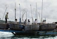 This file illustration photo shows Vietnamese fishermen, heading out to sea, in 2004. Chinese authorities have released 21 Vietnamese fishermen who were detained seven weeks ago near disputed islands in the South China Sea, drawing strong protests from Hanoi