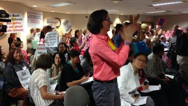 Supporters of the new policy at the Vancouver School Board cheer after the ruling. (CBC Photo)