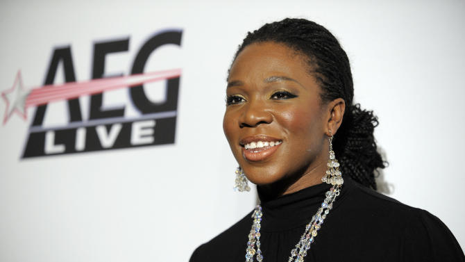 "FILE - In this Jan. 30, 2010 file photo, India.Arie arrives at the annual Pre-GRAMMY Gala presented by The Recording Academy and Clive Davis at The Beverly Hilton Hotel in Beverly, Hills, Calif. The R&B songstress is known for singing about being authentic and celebrating one's true self. But some accused India.Arie of lightening her skin when a publicity photo for her song ""Cocoa Butter"" released this week made it look as though she were several shades lighter than her dark brown complexion. (AP Photo/Chris Pizzello, File)"