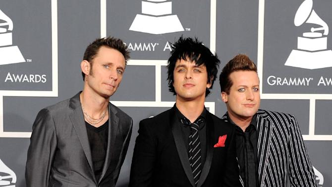 FILE - In this Jan. 31, 2010, file photo, Green Day arrives at the Grammy Awards in Los Angeles. Rock Hall spokesman Todd Mesek said Monday, April, 9, 2012, that Green Day members Billie Joe Armstrong, Mike Dirnt and Tre Cool will induct Guns N' Roses at Saturday's ceremony at Cleveland's Public Hall. (AP Photo/Chris Pizzello, File)