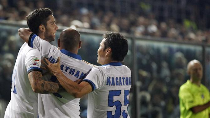 Inter Milan's Ricardo Alvarez, left, of Argentina, celebrates with teammates after scoring during a Serie A soccer match against Atalanta in Bergamo, Italy, Tuesday, Oct. 29, 2013