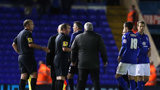 Bolton manager Owen Coyle confronts the officials after the game at Birmingham