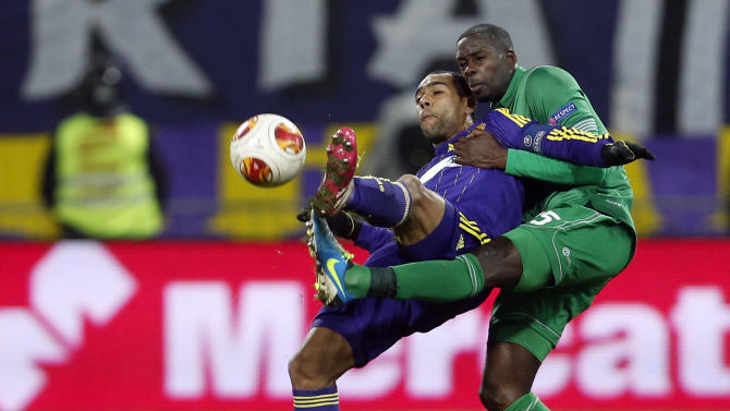 Wigan's Leon Barnett, right, is challenged by Maribor's Tavares during their group D Europa League soccer match, in Maribor, Slovenia, Thursday, Dec. 12, 2013