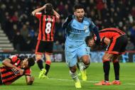 Manchester City's striker Sergio Aguero (2nd R) celebrates after scoring their second goal during the English Premier League football match between Bournemouth and Manchester City at the Vitality Stadium on February 13, 2017
