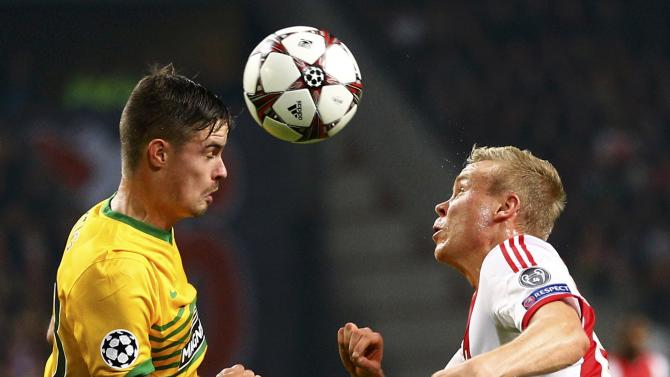 Celtic's Lustig and Ajax Amsterdam's Sigthorsson head the ball during their Champions League soccer match at Amsterdam Arena