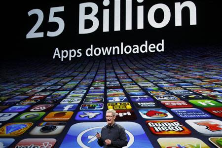 Apple CEO Tim Cook speaks about the number of Apps downloaded during an Apple event in San Francisco, California in this file photo from March 7, 2012. REUTERS/Robert Galbraith/Files