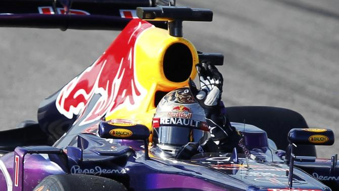 Sebastian Vettel of Germany waves to fans after winning the Austin F1 Grand Prix at the Circuit of the Americas in Austin