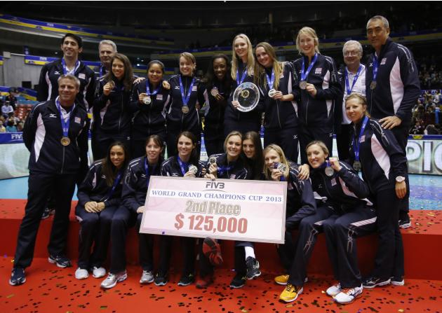 Players and staff of the U.S. team pose after placing second on the final day of the FIVB Women's Volleyball World Grand Champions Cup in Tokyo