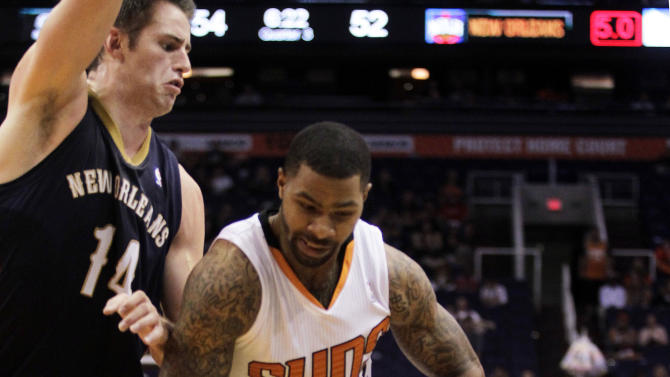 Phoenix Suns forward Marcus Morris (15), right, drives on New Orleans Pelicans center Jason Smith (14) in the third quarter during an NBA basketball game on Sunday, Nov. 10, 2013, in Phoenix. The Suns defeated the Pelicans 101-94