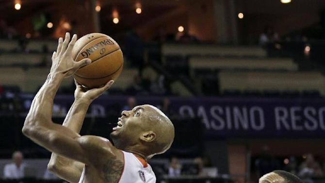 Charlotte Bobcats' Gerald Henderson (9) drives past Philadelphia 76ers' Elliot Williams during the first half of an NBA basketball game in Charlotte, N.C., Friday, Dec. 6, 2013