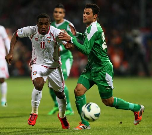 Ahmed Khalil (L) of United Arab Emirates vies for the ball against Waleed Salem al-Lami of Iraq during their 21st Gulf Cup football match final in Manama, on January 18, 2013. AFP PHOTO/MARWAN NAAMANI