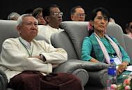 Myanmar democracy icon Aung San Suu Kyi (R), seen here attending the country's first forum on Green Economy and Green Growth in Yangon, on November 4. The authorities have given the green light to Suu Kyi's opposition to rejoin mainstream politics, setting the scene for the Nobel laureate to run for a seat in the new parliament