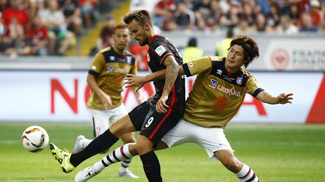 Seferovic of German first soccer division Bundesliga club Eintracht Frankfurt challenges Yoshimoto of FC Tokyo during their pre-season friendly soccer match in Frankfurt