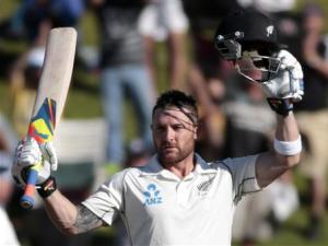 New Zealand's McCullum signals his 100 against India durIng the second innings in Wellington