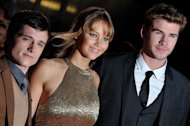 (L-R) Josh Hutcherson, Jennifer Lawrence and Liam Hemsworth