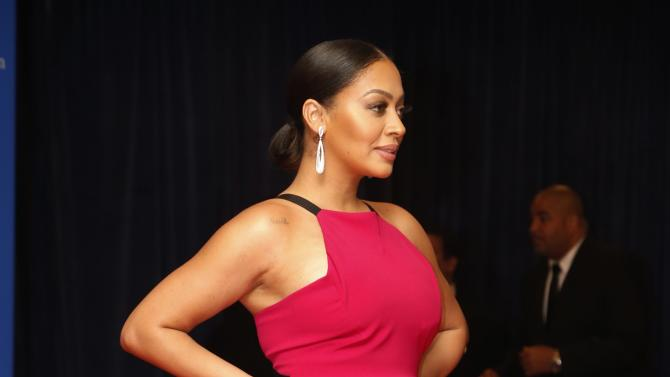 Lala Anthony, wife of NBA basketball player Carmelo Anthony, arrives on the red carpet for the annual White House Correspondents Association Dinner in Washington