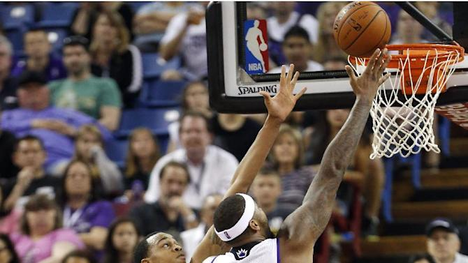 Cousins, Thomas lead Kings past Bucks 124-107