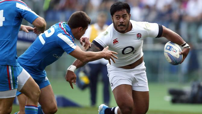England's Tuilagi runs with the ball as Italy's Garcia tries to tackle during Six Nations rugby union match in Rome