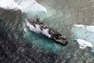 Aerial shot on January 19, 2013 of a US Navy minesweeper trapped on the Tubbataha reef in the Philippines. A Chinese fishing boat has now run aground on the same World Heritage-listed coral reef